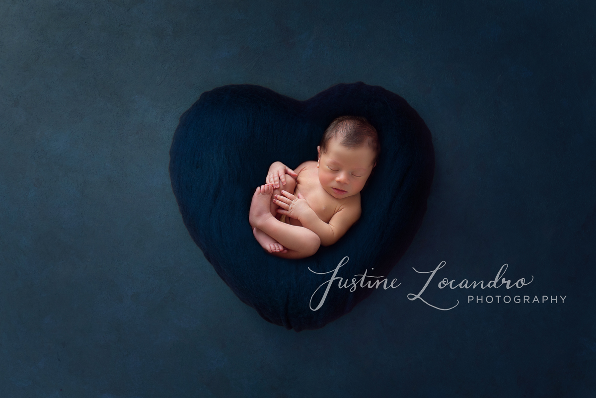 Photograph of newborn baby boy in blue heart
