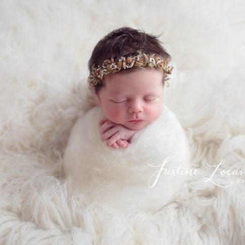 Photograph of Ballarat newborn baby girl in potato sack pose