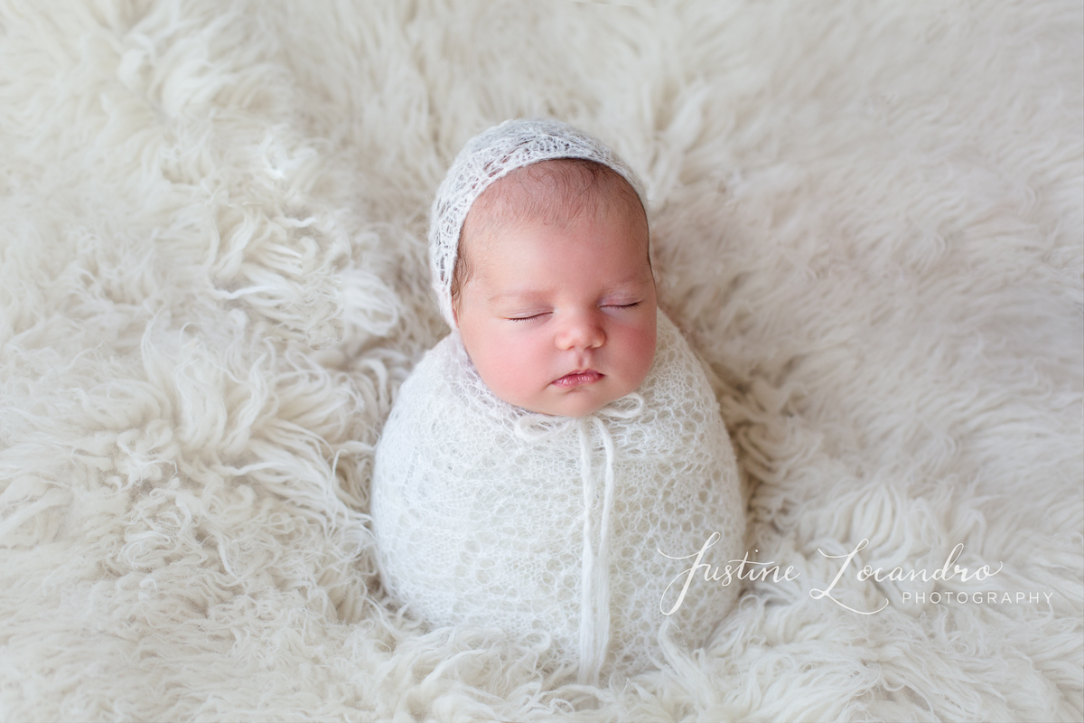 Newborn baby girl in potato sack pose. Taken by Ballarat newborn photographer Justine Locandro Photography
